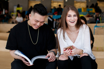 Male and Female student studying