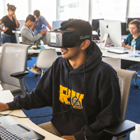 male student using virtual reality headset