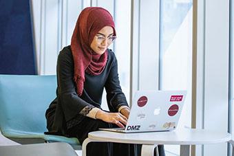 Female student studying on laptop