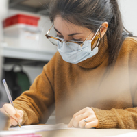 Student wearing face-mask studying